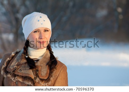 Winter outdoor portrait of cute girl