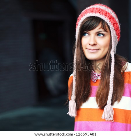 Winter outdoor portrait of pretty funny young brunette