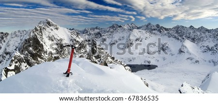 Winter panorama of the of the Tatra Mountains with ice axe. Five Lakes Valley from Maly Kozi. - stock photo