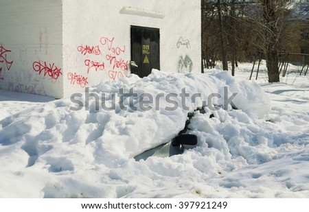 Winter parking of the car under a snow fur coat - stock photo