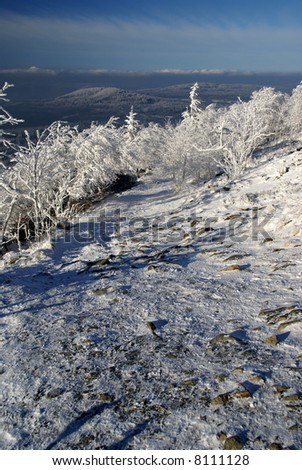 Winter path with beautiful lookout (north Bohemia). - stock photo