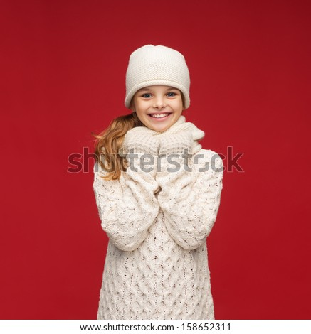 winter, people, happiness concept - girl in hat, muffler and gloves - stock photo