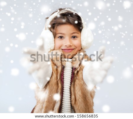 winter, people, happiness concept - happy little girl in winter clothes - stock photo
