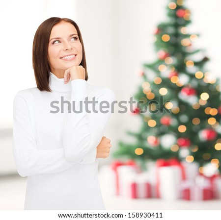 winter, people, happiness concept - thinking and smiling woman in white sweater - stock photo