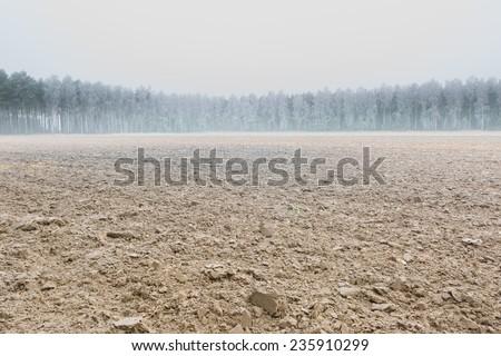 winter plowed field landscape - stock photo
