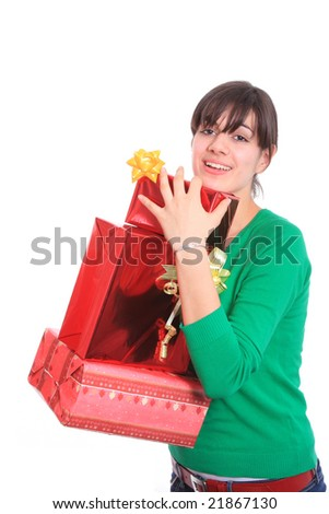 winter portrait of a beautiful young smiling woman with gifts