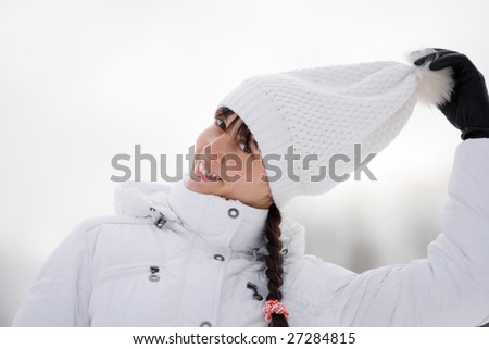 Winter portrait of a happy playful girl - Shallow DOF - stock photo