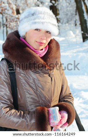 Winter portrait of a pretty girl outdoors