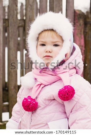 Winter portrait of adorable  child girl in warm clothes - stock photo