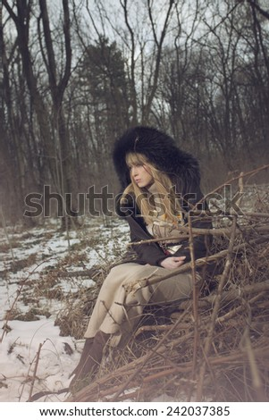 winter portrait of blond woman with hood
