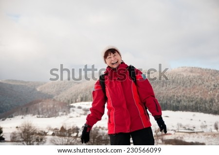 Winter portrait of senior mature in mountain snowy land - stock photo