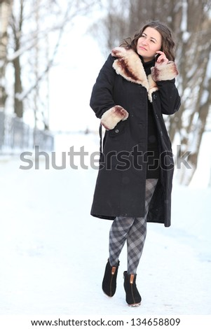 winter portrait of young woman on the street