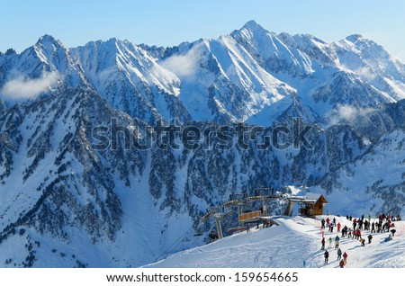 Winter Pyrenees is photographed at the Cauterets ski resort. Many skiers have been transported with Grand Barbat Chair lift up the snowy slope at the Cirque du Lys.  - stock photo