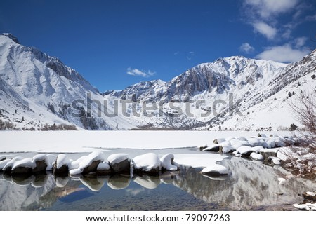 Winter reflections at Convict Lake in eastern Sierra Nevada mountains of California - stock photo