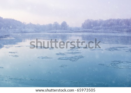 Winter River During Snowfall - stock photo