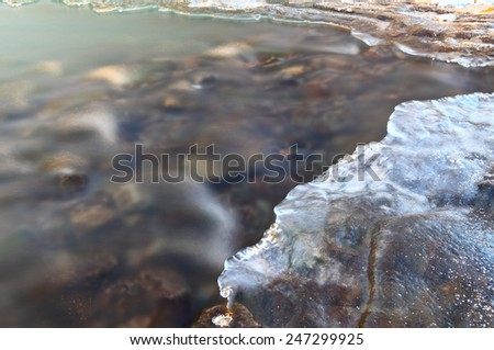Winter river icy stream at very cold weather. Beautiful Christmas card. - stock photo