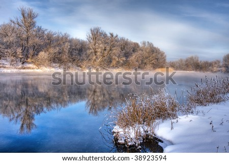 Winter river with clear reflection - stock photo