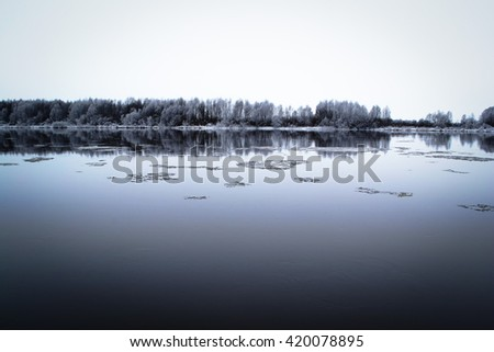 Winter river with floating blocks of ice