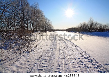 winter road against sun - stock photo