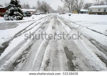 Winter road in a neighborhood - stock photo