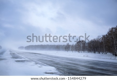 winter road in snow forest - stock photo