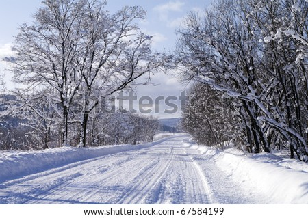 Winter road to frosty day - stock photo