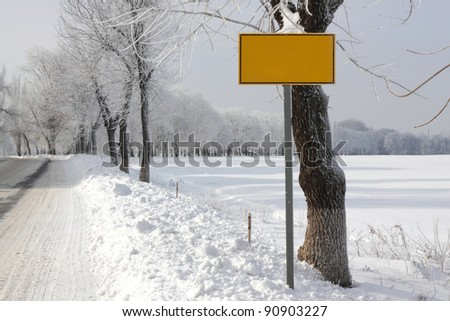 winter road with traffic sign - stock photo