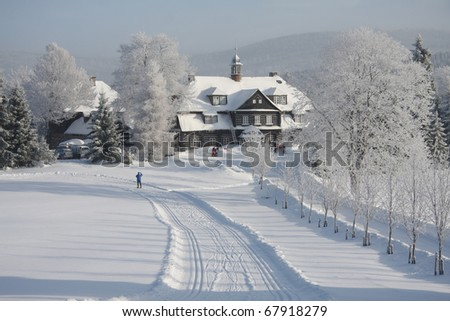Winter romantic wooden old hut - stock photo