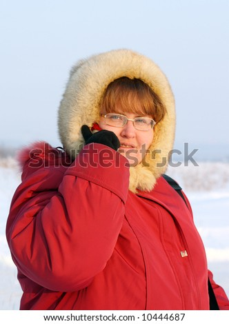 winter, russian plump woman with phone - stock photo