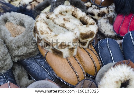 Winter's warm domestic slippers from a sheepskin - stock photo