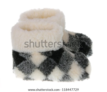 Winter's warm domestic slippers from a sheepskin. Isolated on white. - stock photo