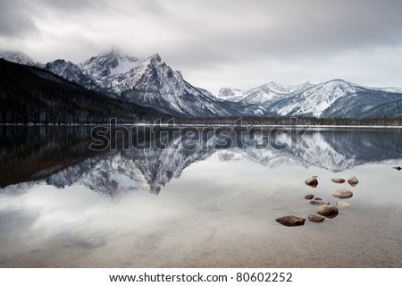 Winter Sawtooth Range Landscape Reflection Smooth Lake Stanley Idaho - stock photo