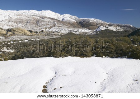 Winter scene along Highway 33 after a fresh snowfall north of Ojai, California - stock photo