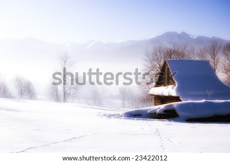 Winter scene in mountains. Old house and snow - stock photo