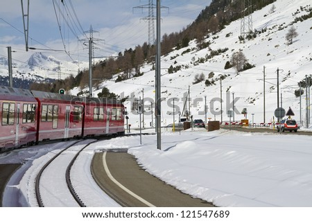 Winter scene near railway crossing at the Bernina Pass. - stock photo