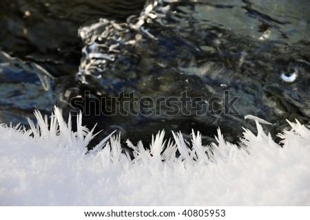 Winter scene of a running creek and ice in johnston canyon, banff national park, alberta, canada