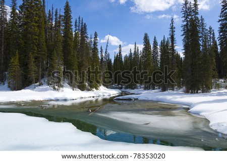 Winter scene of Emerald Lake, located in Yoho National Park, British Columbia, Canada Frozen over and accessable for snow shoeing and ice fishing - stock photo