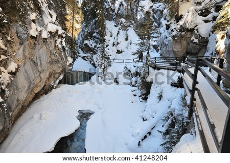 Winter scene of johnston canyon and snow covered creek, banff national park, alberta, canada - stock photo