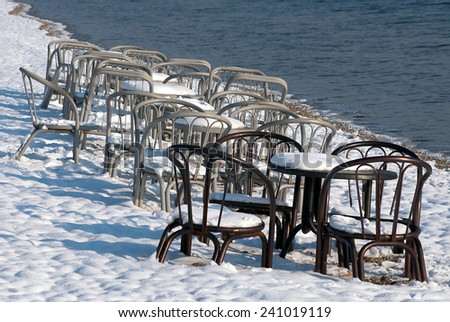Winter scene on the lake shore - stock photo