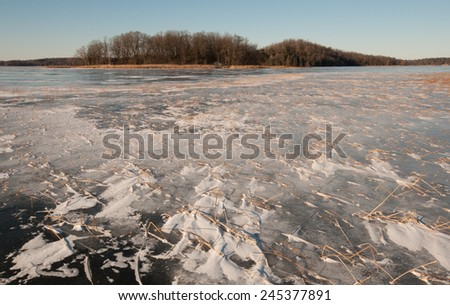Winter scene: wide angle view of frozen lake - stock photo