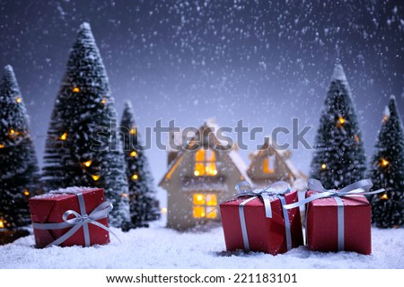 winter scene with Christmas tree,miniature of apartment and gift boxes.Christmas concept. - stock photo