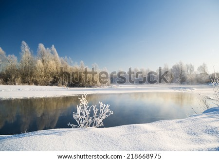 winter scene with river background. - stock photo