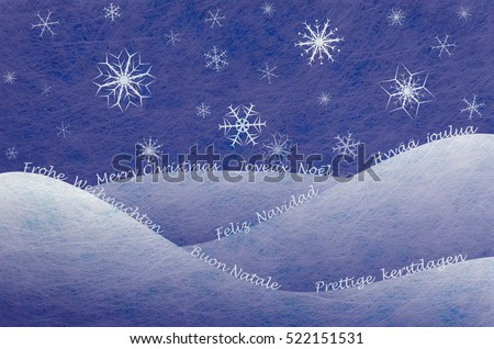Winter scene with snowy mountains the words for Merry Christmas in several european languages, christmas card