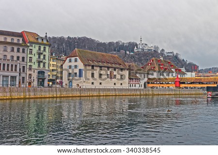 Winter scenery on the embankment of Reuss river in the popular swiss city of Lucerne. It is the fourth largest river in Switzerland - stock photo