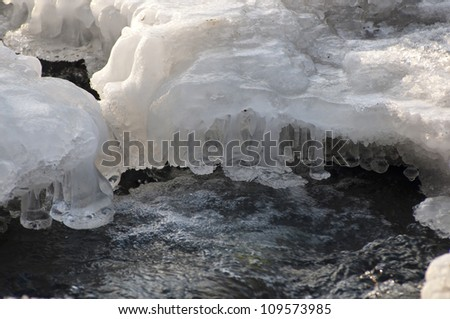 Winter scenery with frozen river