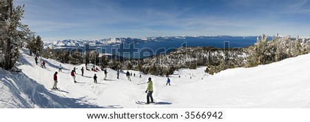 Winter scenic of people skiing by lake tahoe