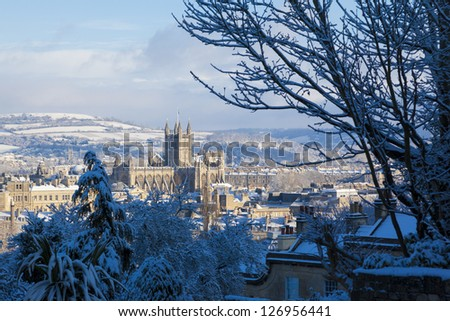 Winter scenic showing Bath Abbey surrounded by Georgian architecture and countryside in Bath, England, UK. - stock photo