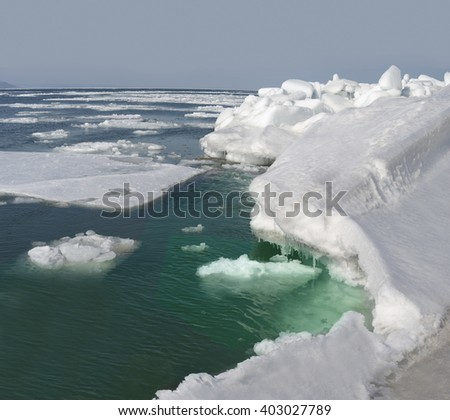 Winter  sea  ice  covered  with  snow  on  the  Bay  of   Vladivostok,   Primorye  , Russia