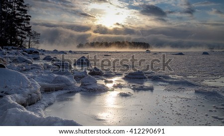 Winter seascape with steaming water