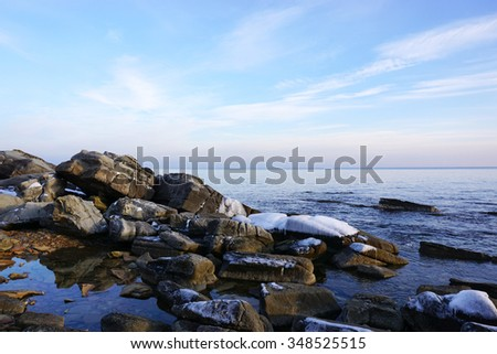 Winter seashore at sunset